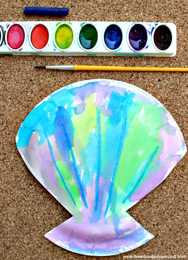 Watercolor paint with watercolor seashell art project made by a toddler or preschooler