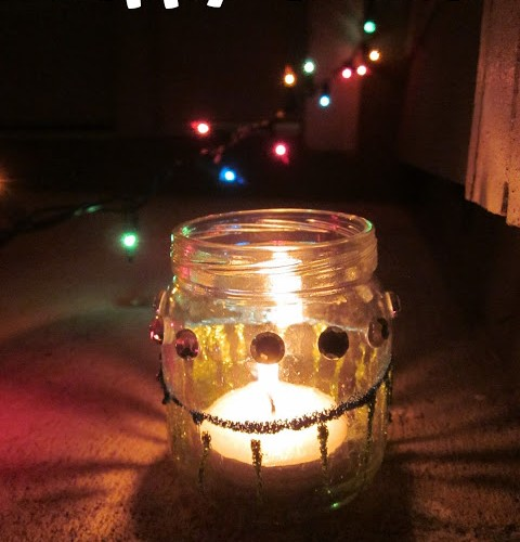 Glass jar Diya decorated with sequins and glitter paint for Diwali with kids