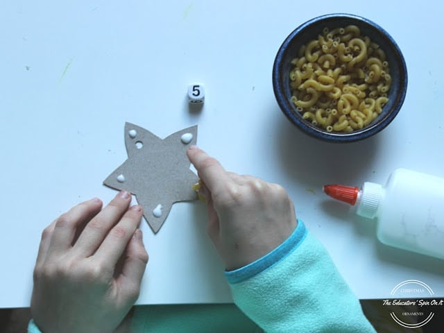 Step by step instructions for super cute and easy star ornament for kids. Math connection too!