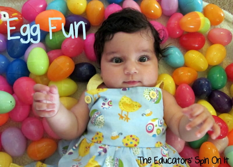baby laying in easter eggs for sensory play