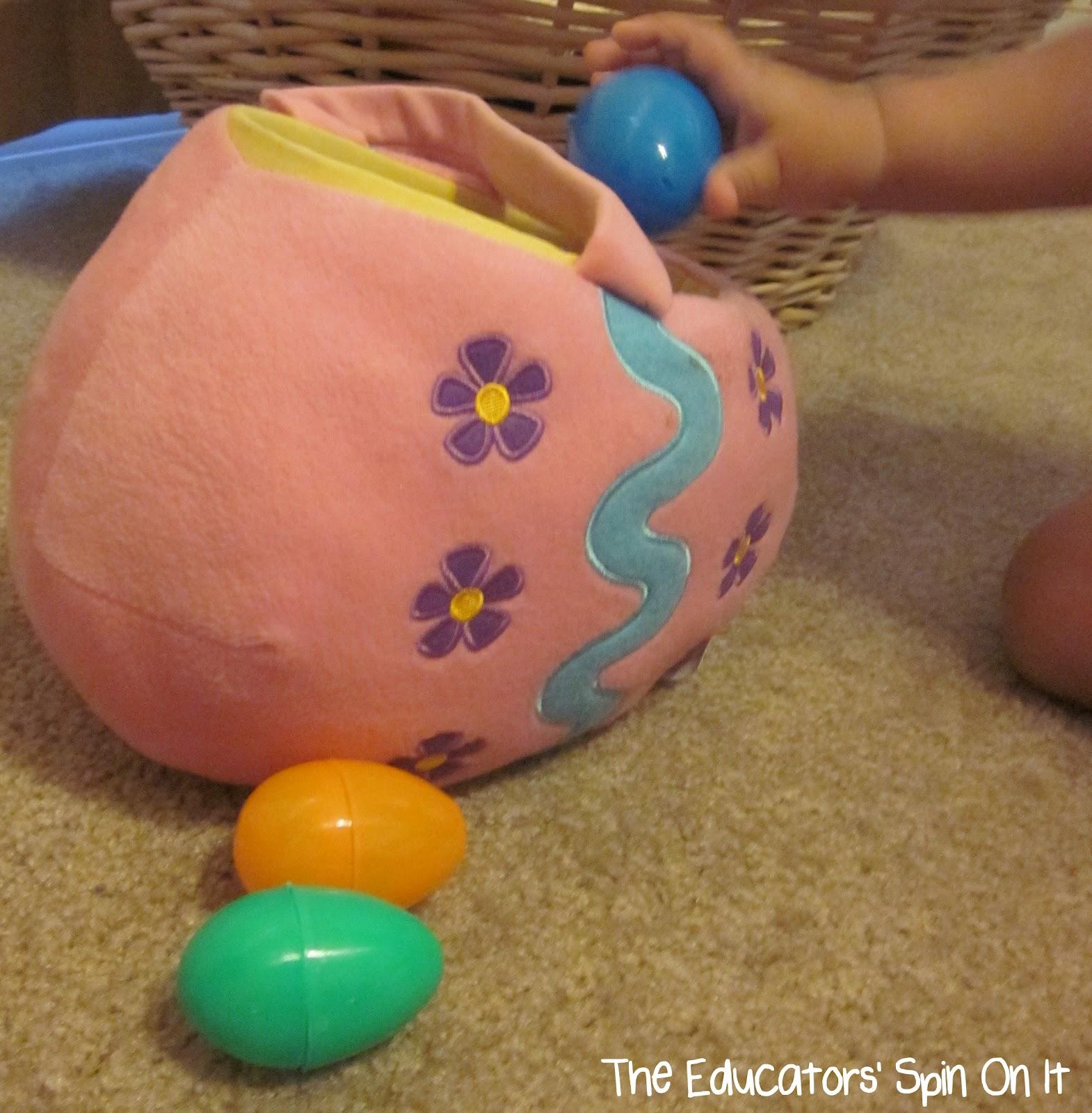 toddler placing easter eggs into soft egg shaped easter basket