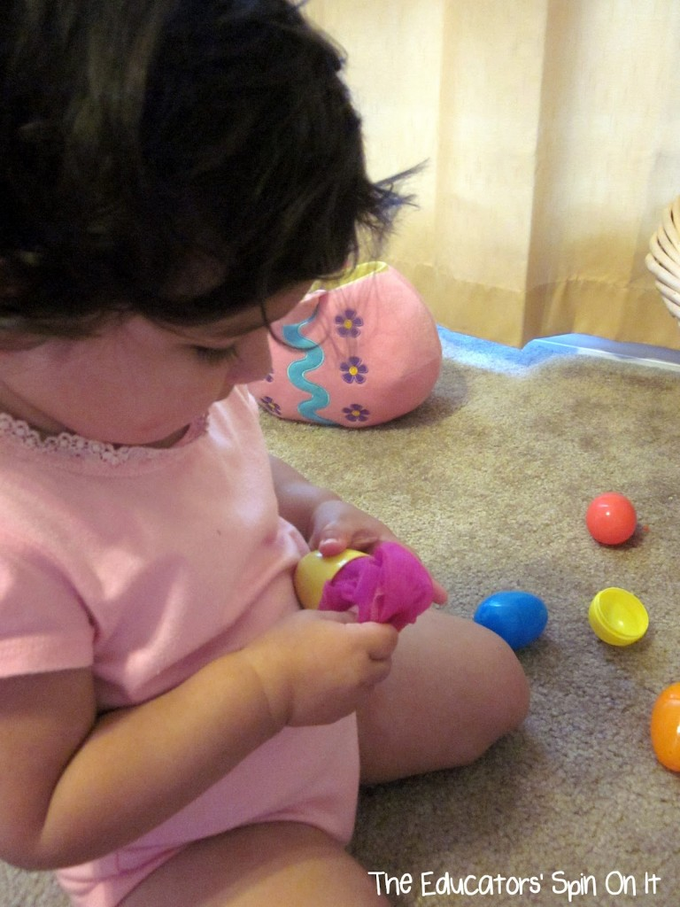 Toddler playing with easter eggs