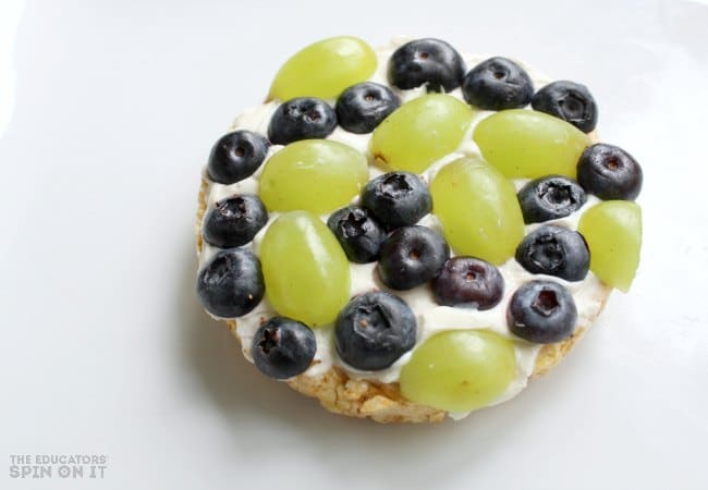 Healthy Earth Day Fruit Snack for Kids with Grapes and Blueberries on Rice Cake