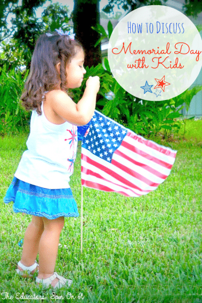 Child blowing bubbles near flag in honor of Memorial Day
