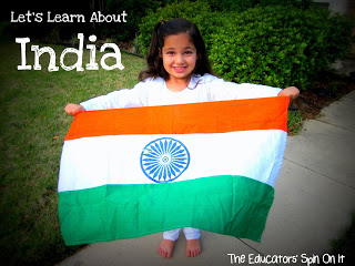 Young girl in white indian clothes holding India flag.