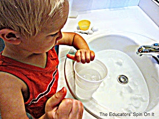 Toddler science introduction to temperature with cold water