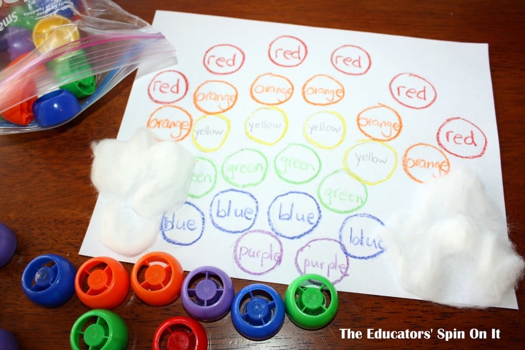 Circles with color words written with colorful recycled lids for learning color words
