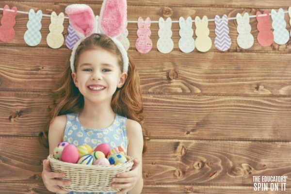 Child with Easter eggs and bunny themed bunting