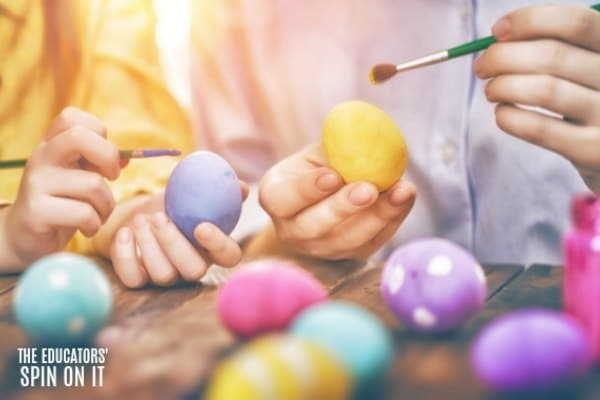 painting yellow, purple, pink and turquoise eggs with kids for easter