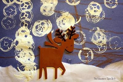 Reindeer art with spool snowflakes on blue paper