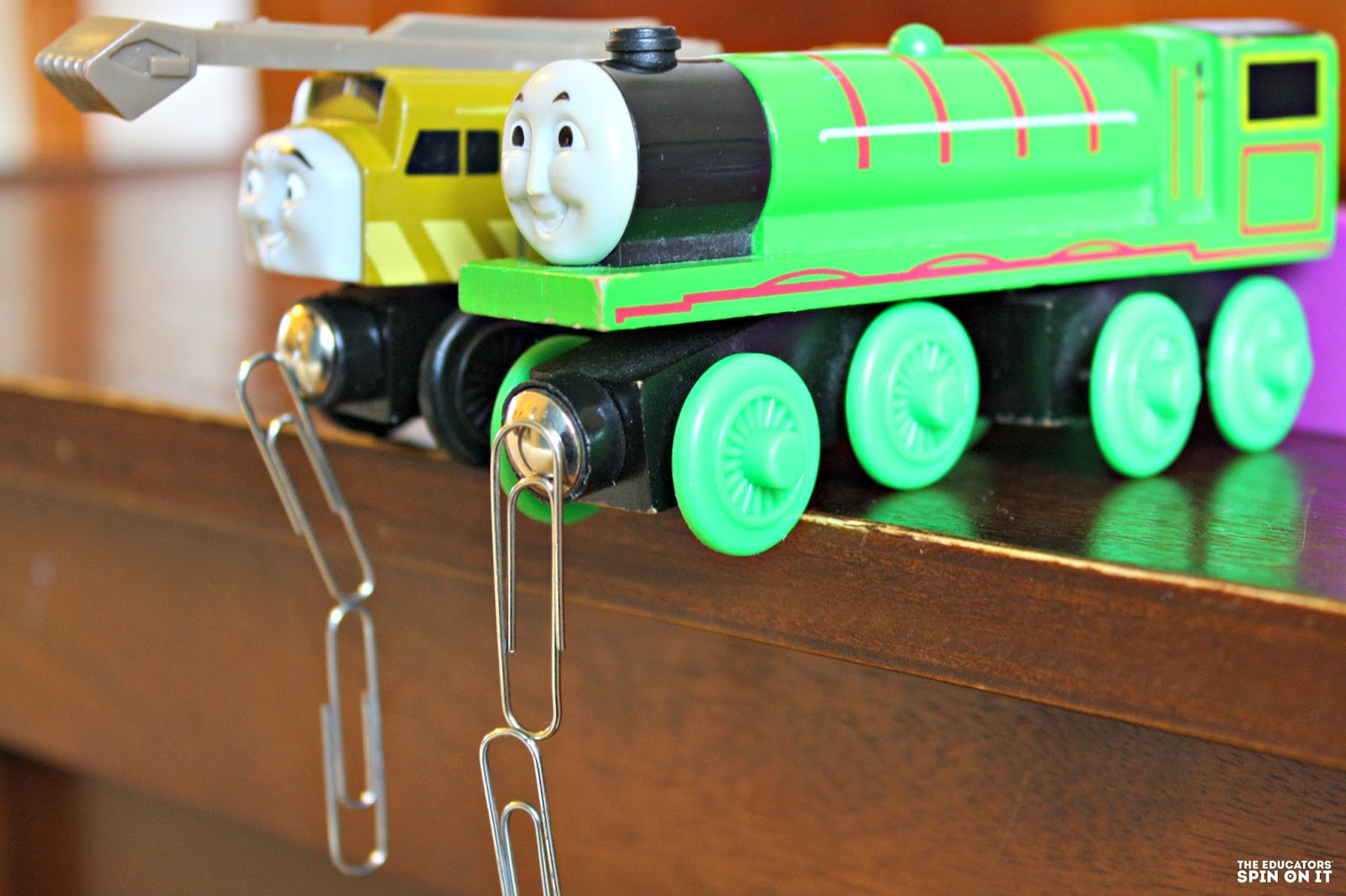 paperclips on wooden trains
