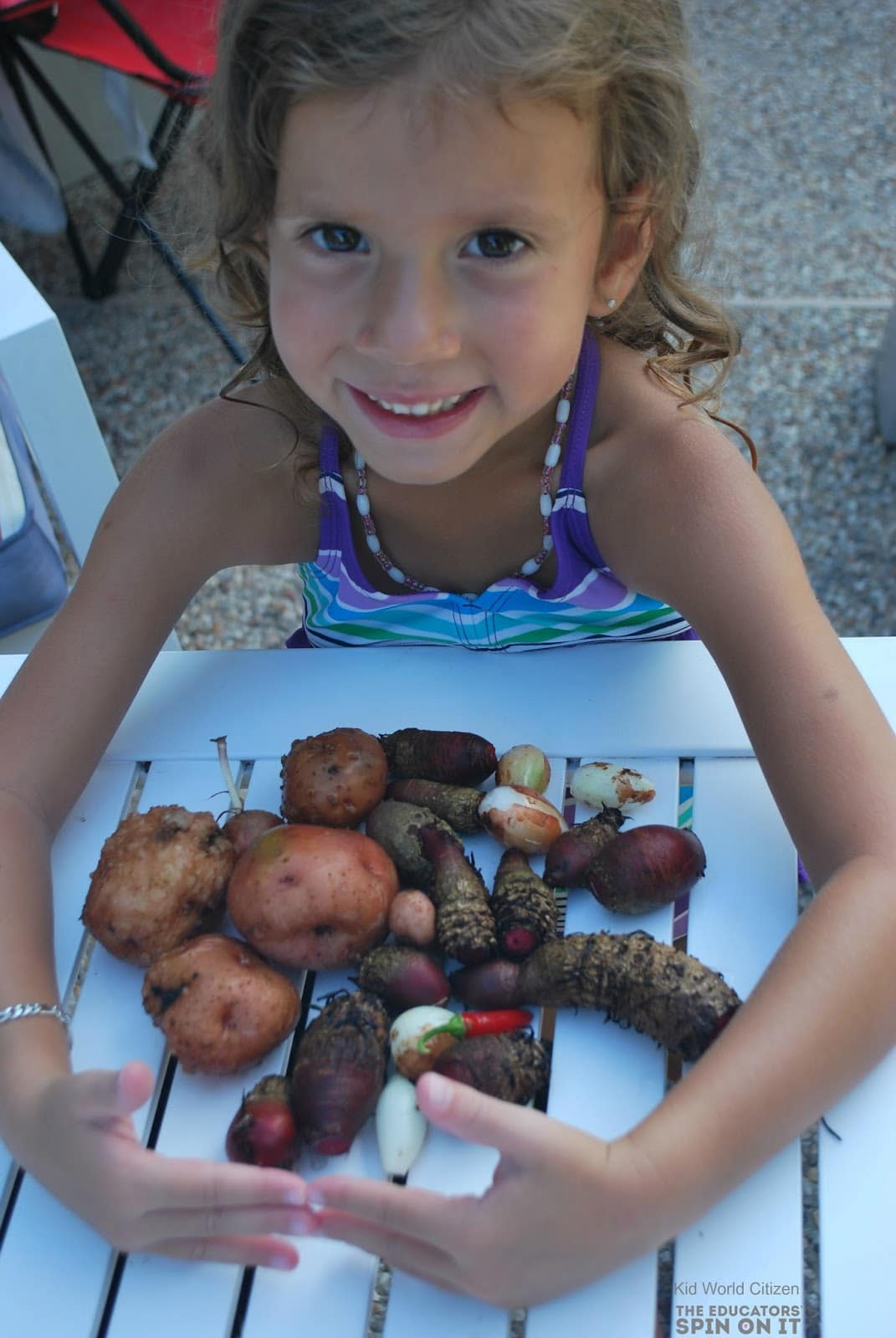 Vegetables to Grow with Kids = POTATOES!  Girl with her garden harvest