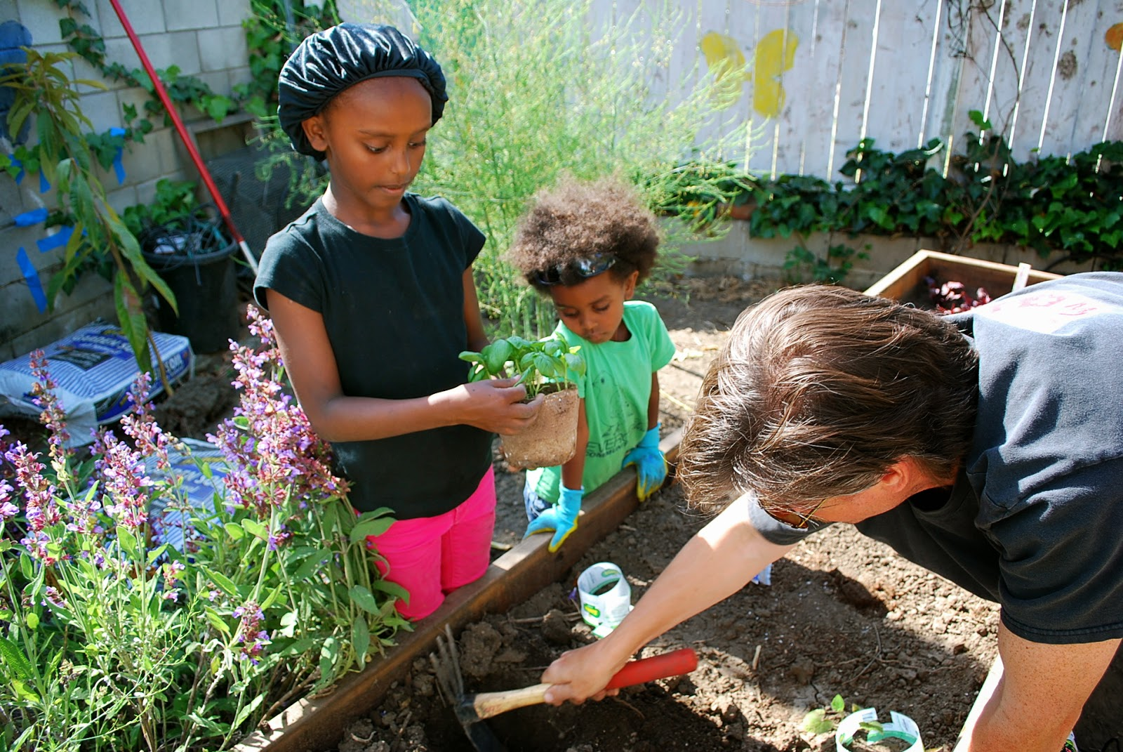 kids in the garden learning about planting