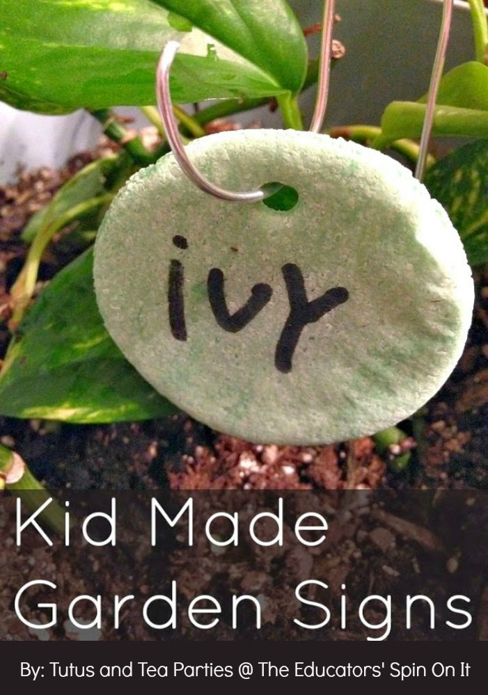 Kid made garden markers to promote literacy in the garden