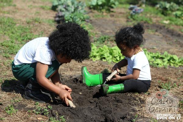 Kids in the garden planting seeds