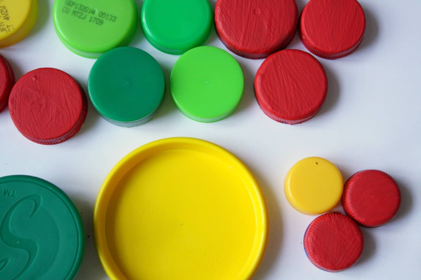 Preschool Activities for Math: Sorting lids by size.