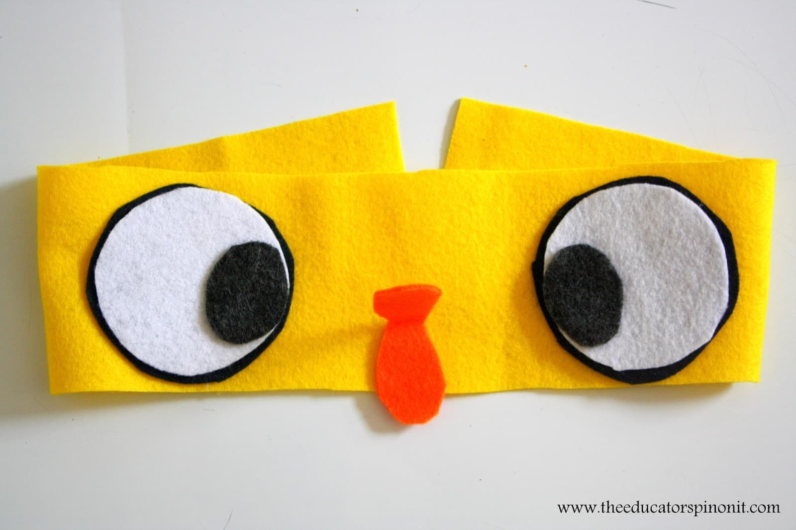 Set out the pieces of the Duckling headband before sewing.