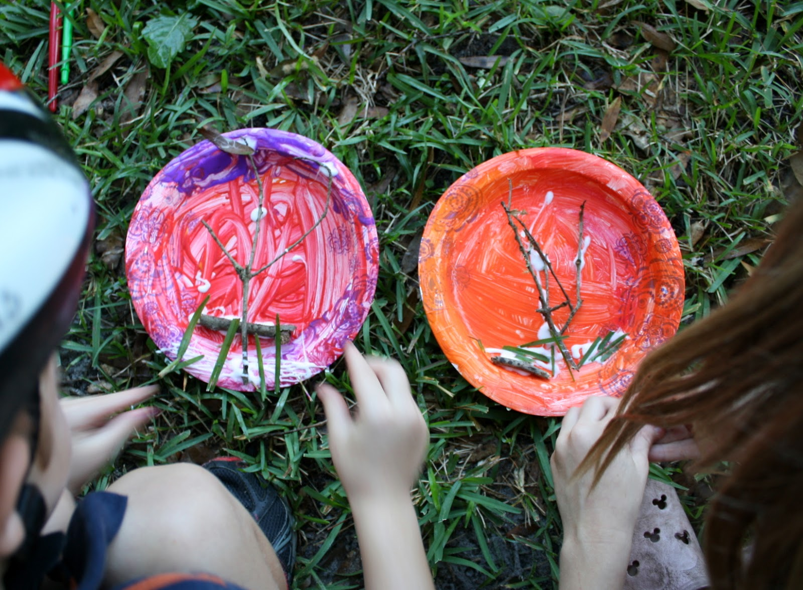 Children making a paper plate fall bug habitat