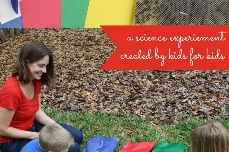 Kids creating ladybug science experiment outdoors on various colored papers