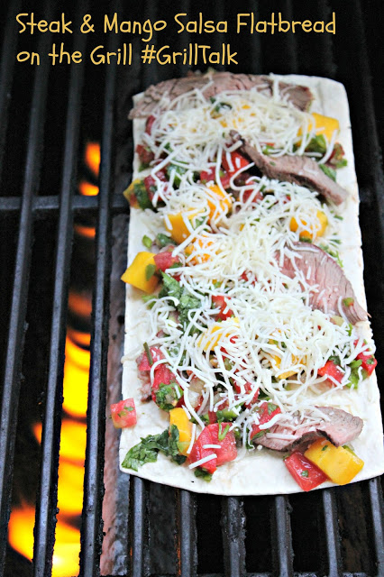 Flatbread pizza on grill with peppers, mangos, cheese and steak