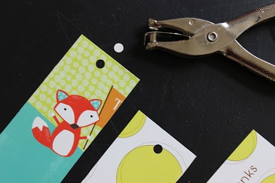 hole punch the top of the cut bookmark