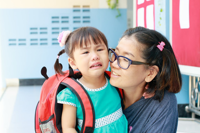 Child anxious about the first day of school, parenting comforting