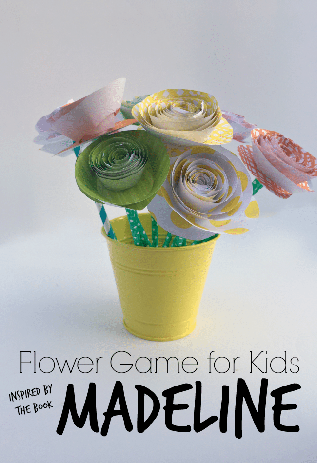 Colorful spiral paper flowers in yellow pot made by kids