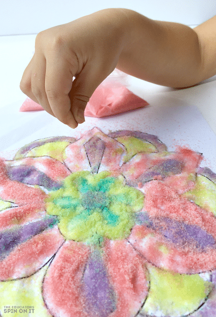 Using Colored Sand to create Rangoli Craft Idea for Kids for Diwali to encourage kids to learn about the world.