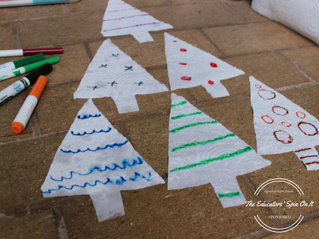 Let the child add ornaments to the tree with different colored markers.  Try a variety of lines, circles, and waves.