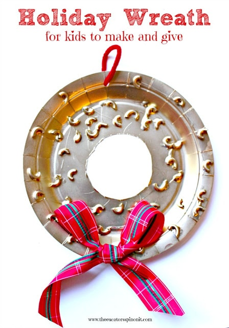 A paper plate holiday wreath for kids to make and give *** This craft doubles as a math game. Click for instruction on how to play!