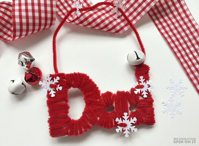 Kids can create a personalized name ornament with just recycled cardboard and pipecleaners for their Christmas Tree or Gift Tags.  Inspired by the book Santa's Book of Names by David McPhail.