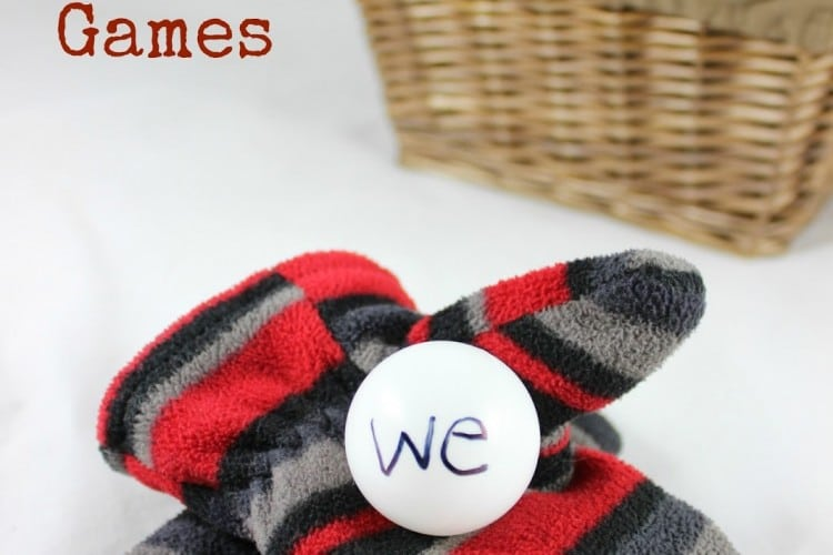 Sight word game using snowballs made from ping pong balls and mittens for kids
