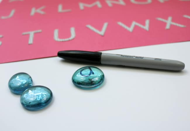 alphabet letters on glass gems with permanent marker