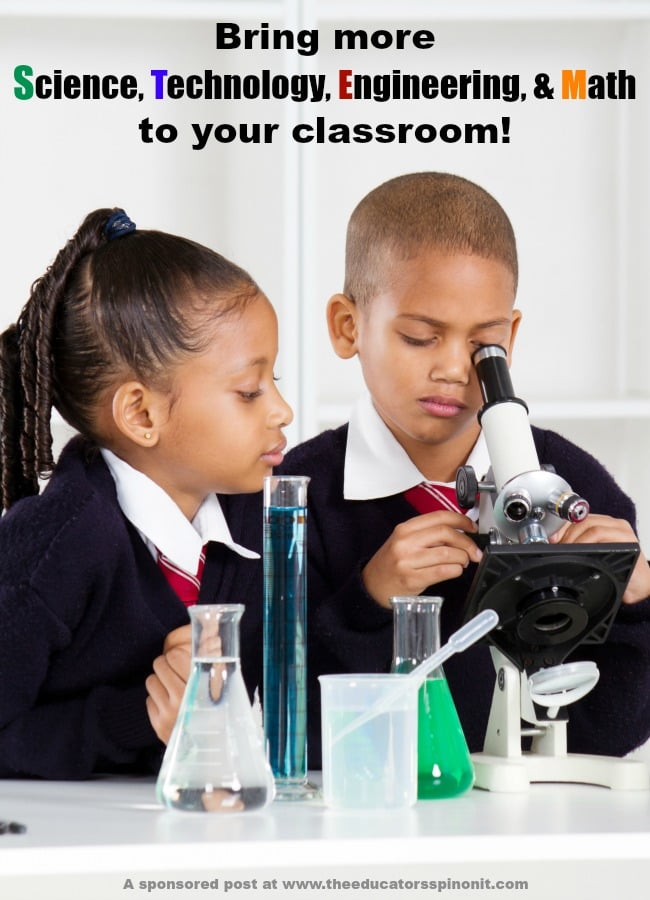 2 kids using a microscrope in an elementary school classroom