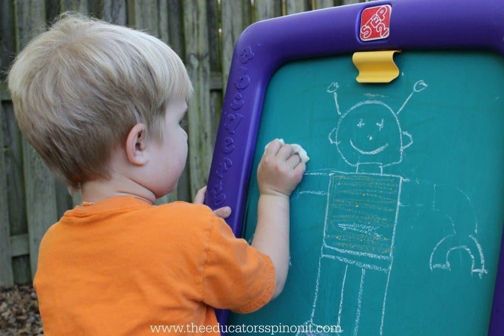 boy erasing robot arm