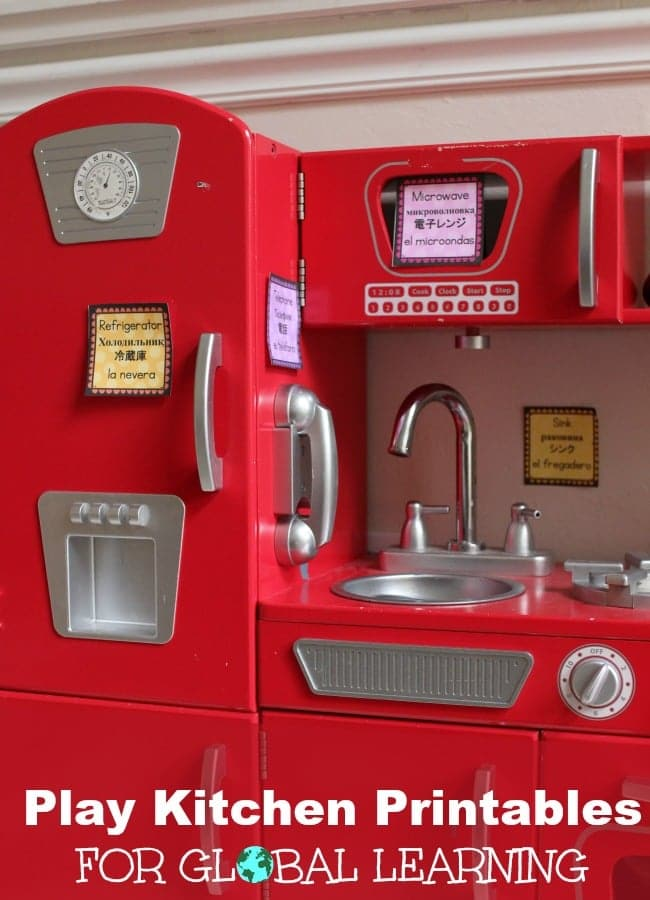 Red pretend play kitchen for kids with labels in 4 languages to include global learning into every day play.