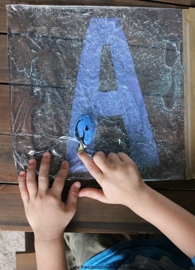 Child learning their Alphabet with hands-on Swimming Letters with Dory Sensory Bag
