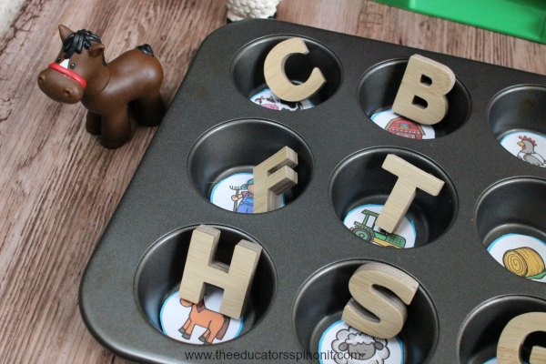Place a set of wooden or magnetic alphabet letters next to the muffin tin. Have the children place the letter that represents the word's beginning sound on top of the picture. B for bard, s for scarecrow, a for acorn.