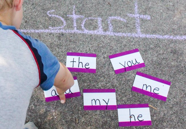 START! Child gets ready to play a sidewalk chalk sight word game