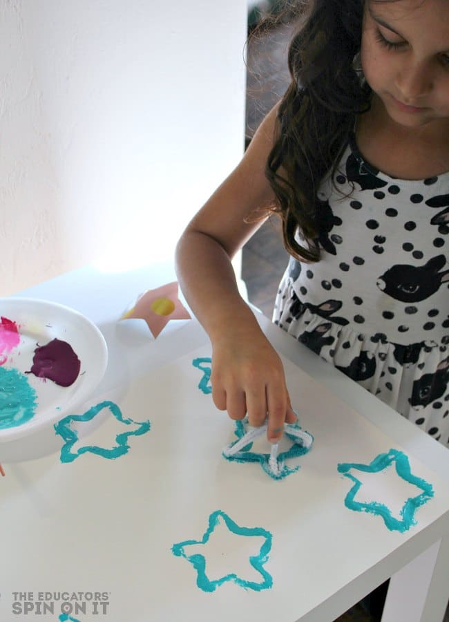 Kids Painting with Star Shaped Stamps