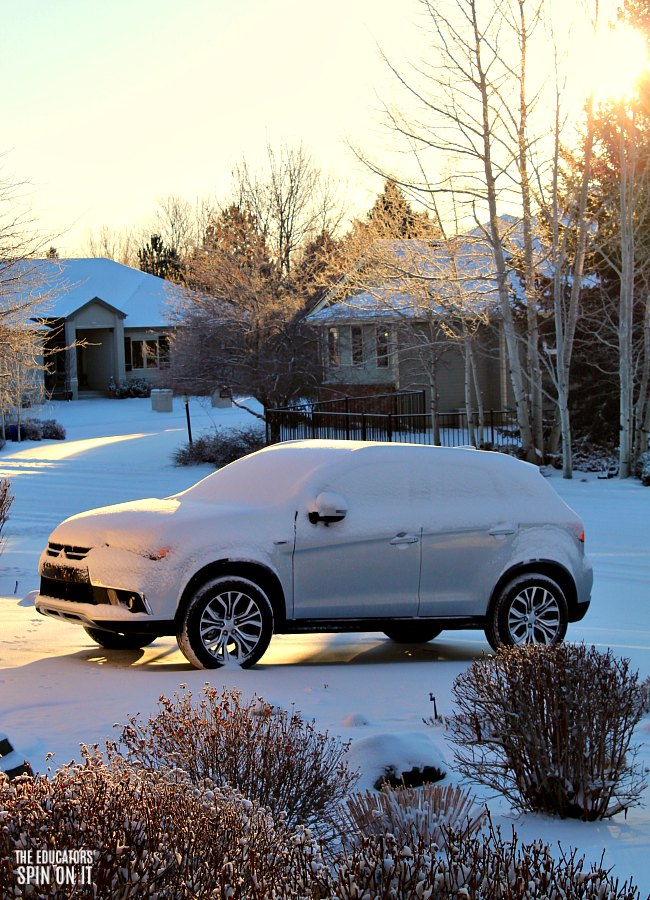 Sunrise over snow covered Mitsubishi Outlander Sport 2.4 Review by Kim Vij