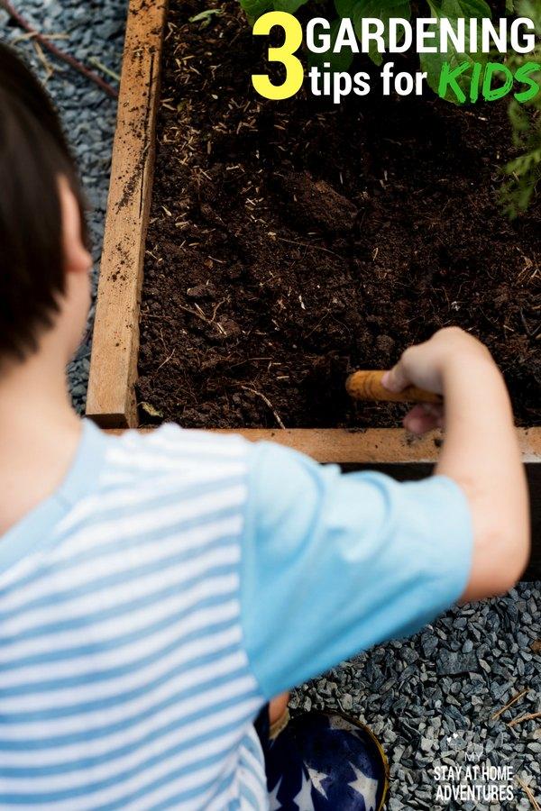 Child digging in garden dirt to start a garden