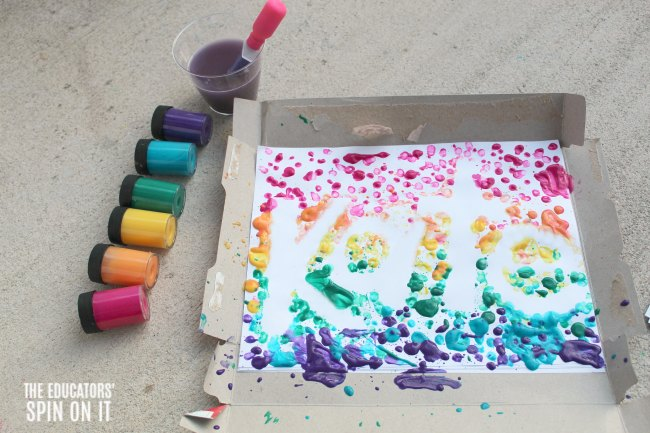Outline of name from dripped paint in rainbow colors