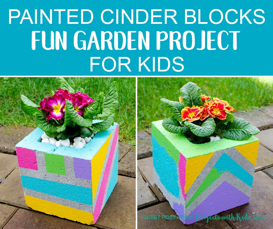 Flowers planted in colorful cinder blocks painted by kids