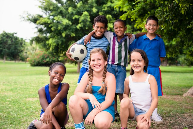Group of children together with soccer ball at school or camp