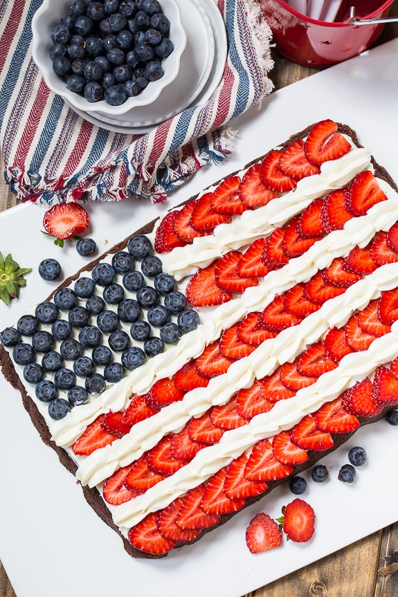 American Flag made with Strawberries and Blueberries on top of Brownie