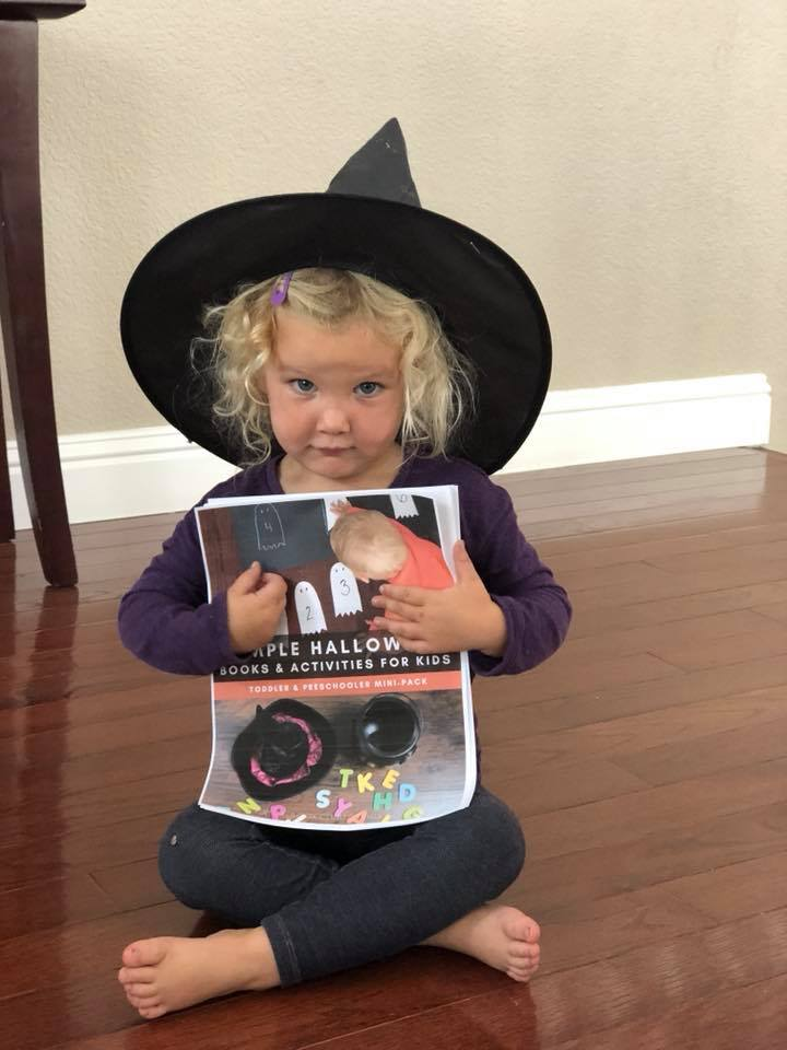 Toddler dressed at Witch sharing Toddler Activities for Halloween