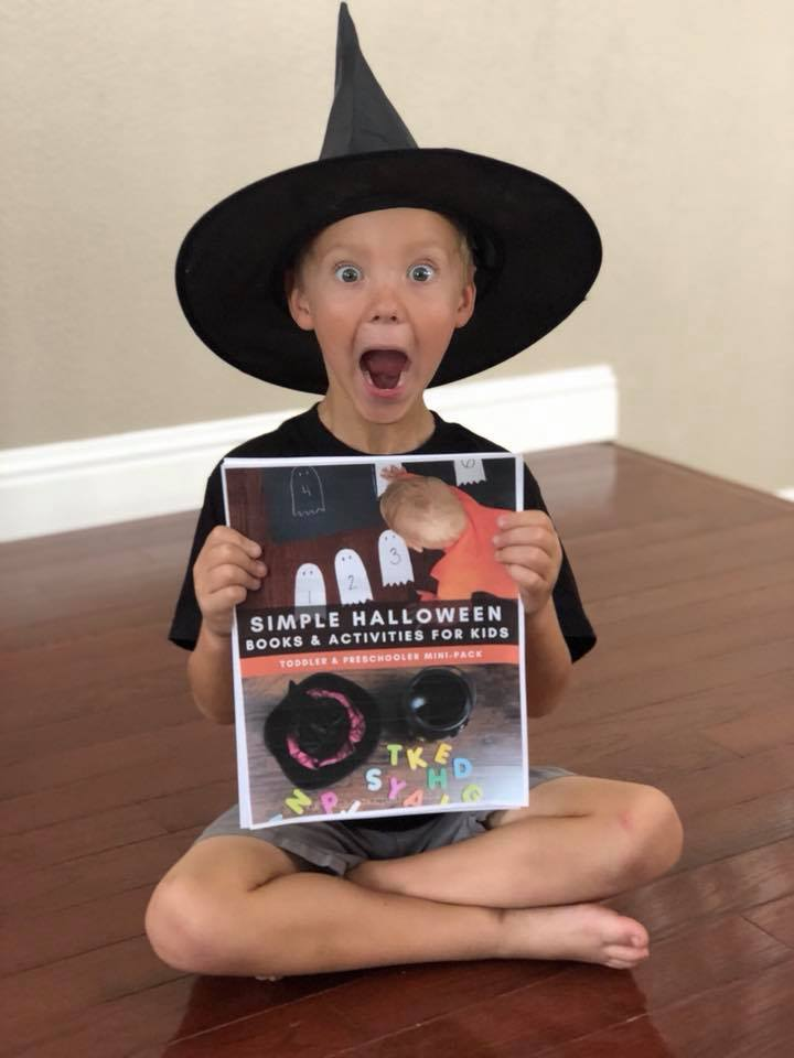 Boy with Witch Hat Holding Printable Halloween ebook for Preschoolers and Toddlers with Activities & Books