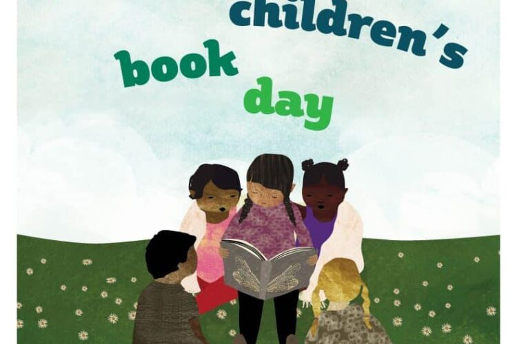 Multicultural Children's Book Day with children reading a book in group on grass with blue sky.