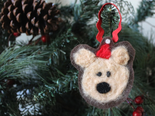 Adorable kid made felted bear ornament idea using wool and felt to hang on christmas tree.